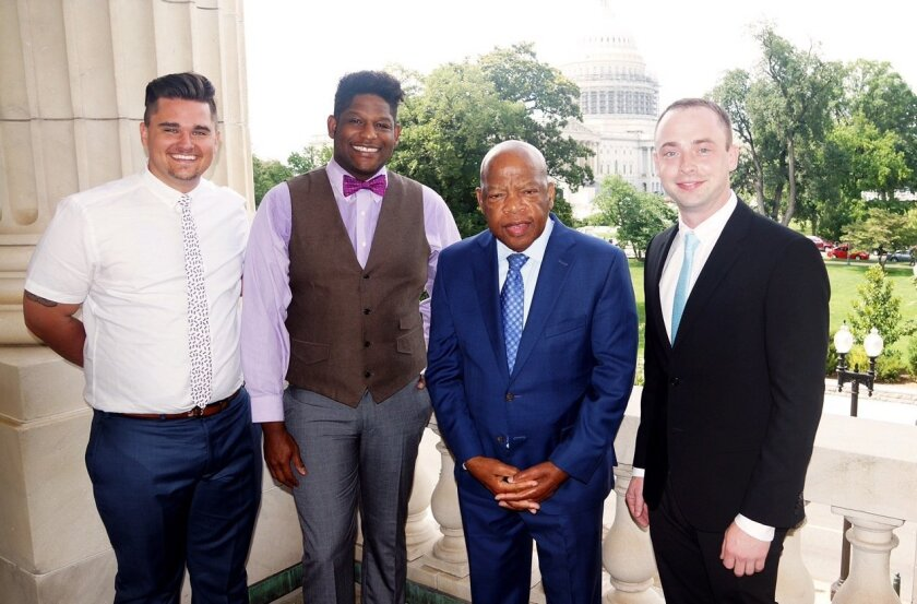 """Taran Gray, Richard Allen and (at right) Joshua Schnose, a producer of """"Freedom Riders,"""" with Rep. John Lewis in Washington, D.C."""