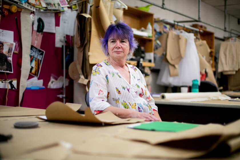 """Barbara """"Babs"""" Behling, a former costume stitcher for The Old Globe, now stitches purses and other items out of leftover costume fabric. Her creations are sold in The Old Globe's Helen Edison Gift Shop."""