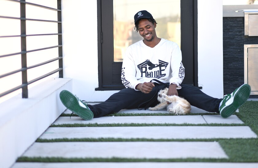 Former Clipper forward Maurice Harkless sits home with his dog, Biggie, in Venice.