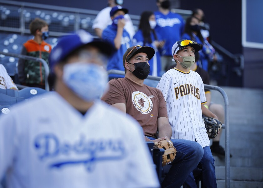 Fans watch as the Padres and Dodgers prepared to play the first of 19 regular-season games Friday at Petco Park.