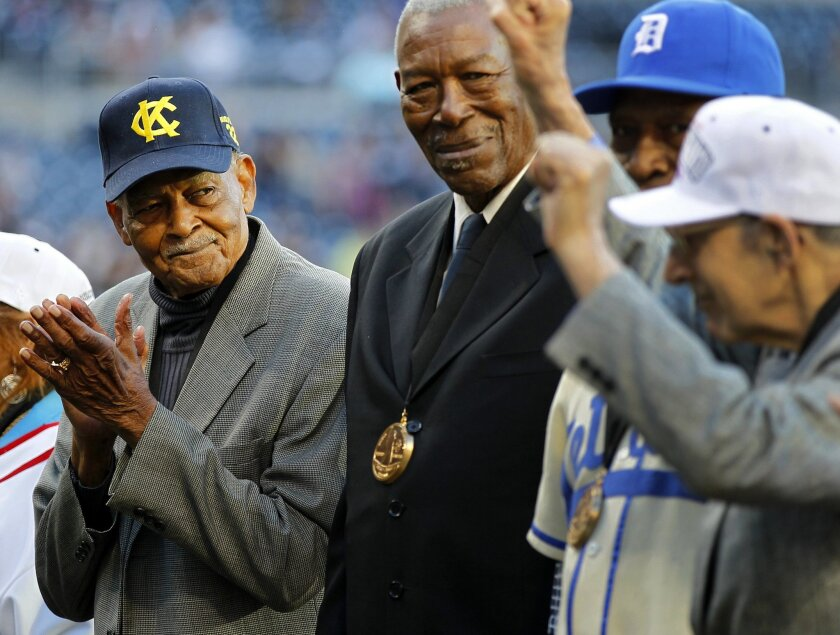 Former Negro League umpire Bob Motley, left, was part of the Padres Salute to the Negro Leagues before the Padres game against the Mariners on Friday, June 22, 2012.