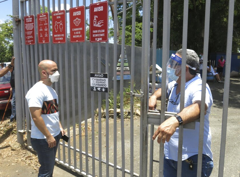 An official tells a voter that the ballots haven't arrived at a voting center in Carolina, Puerto Rico, Aug. 9.