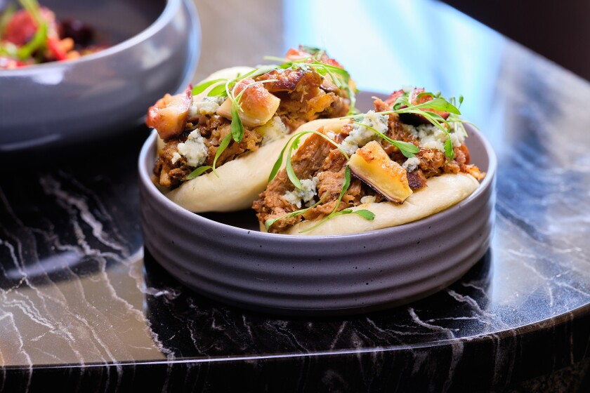 East meets west in the most delicious of ways with Animae's roasted duck bao buns, with maple miso, blue cheese and figs.