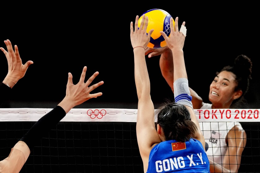 United States' Jordan Thompson, right, hits the ball during the women's volleyball preliminary round pool B match between China and United States at the 2020 Summer Olympics, Tuesday, July 27, 2021, in Tokyo, Japan. (AP Photo/Frank Augstein)