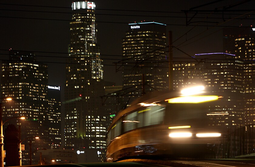 A Gold Line train crosses the 1st Street Bridge in downtown Los Angeles. The Little Tokyo station will be closed until March.