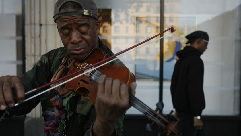 Nathaniel Ayers plays the violin on 4th Street in downtown Los Angeles in 2008.
