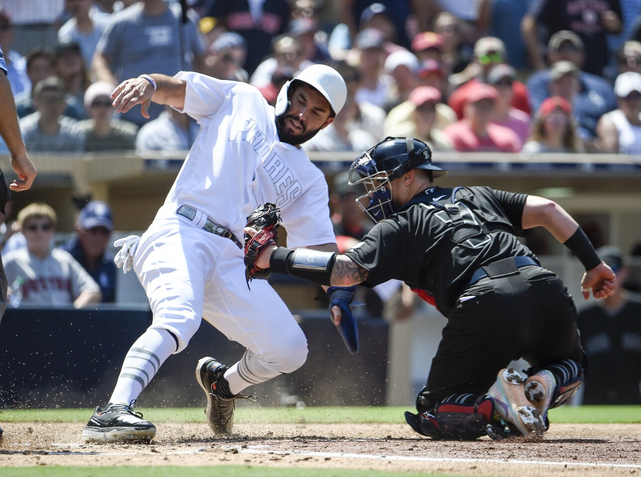 SAN DIEGO, CA - AUGUST 25: Eric Hosmer #30 of the San Diego Padres is tagged out at the plate by Christian Vazquez #7 of the Boston Red Sox during the third inning of a baseball game at Petco Park August 25, 2019 in San Diego, California. Teams are wearing special color schemed uniforms with players choosing nicknames to display for Players' Weekend. (Photo by Denis Poroy/Getty Images) ** OUTS - ELSENT, FPG, CM - OUTS * NM, PH, VA if sourced by CT, LA or MoD **