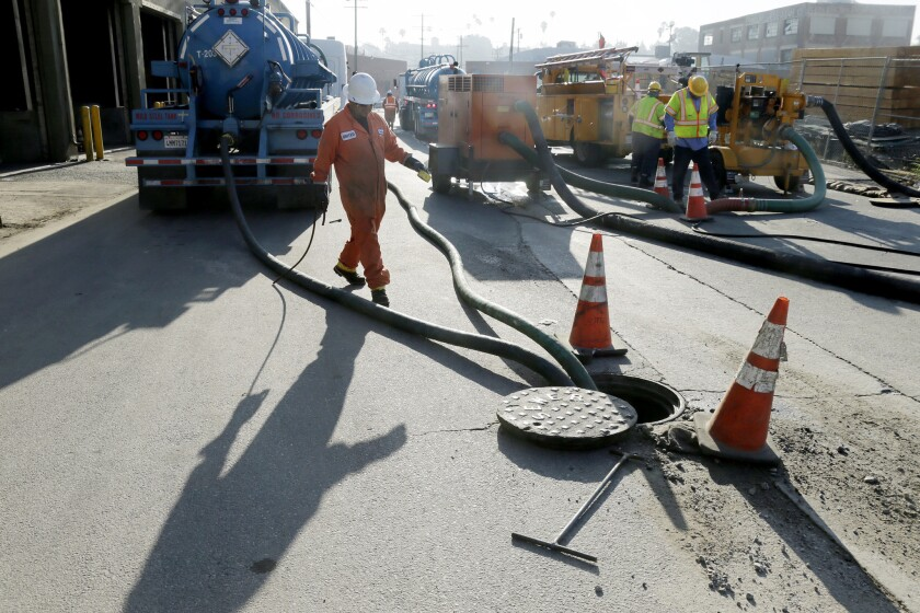 Repair work is underway July 19 after a sewage spill at Mission Road and 6th Street in Boyle Heights.
