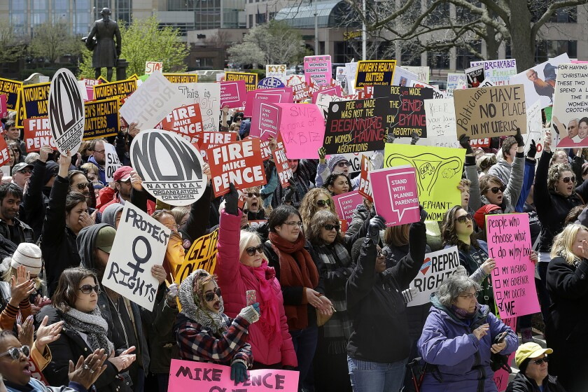 Hundreds of abortion rights supporters gather at the Indiana Statehouse on April 9, 2016, in Indianapolis to protest an anti-abortion law signed by Gov. Mike Pence, that is among the most restrictive in the U.S.