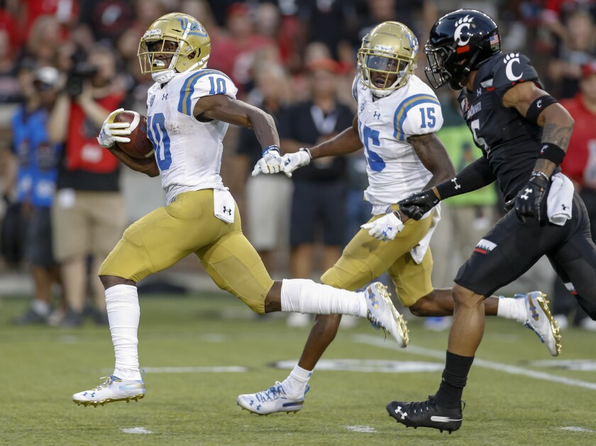 UCLA running back Demetric Felton carries the ball for a touchdown during the second quarter of the Bruins' loss to Cincinnati on Thursday.