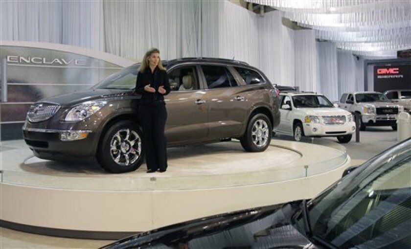 FILE - In this Sept. 30, 2008 file photo, Brenda Brandt talks about the 2009 Buick Enclave to a sparse crowd during the auto show at the State Fair of Texas, in Dallas. General Motors Co. said Tuesday, June 8, 2010, it was recalling about 1.5 million vehicles worldwide to address a problem with a heated windshield wiper fluid system that could lead to a fire, its second recall over the issue in two years.(AP Photo/Matt Slocum, file)