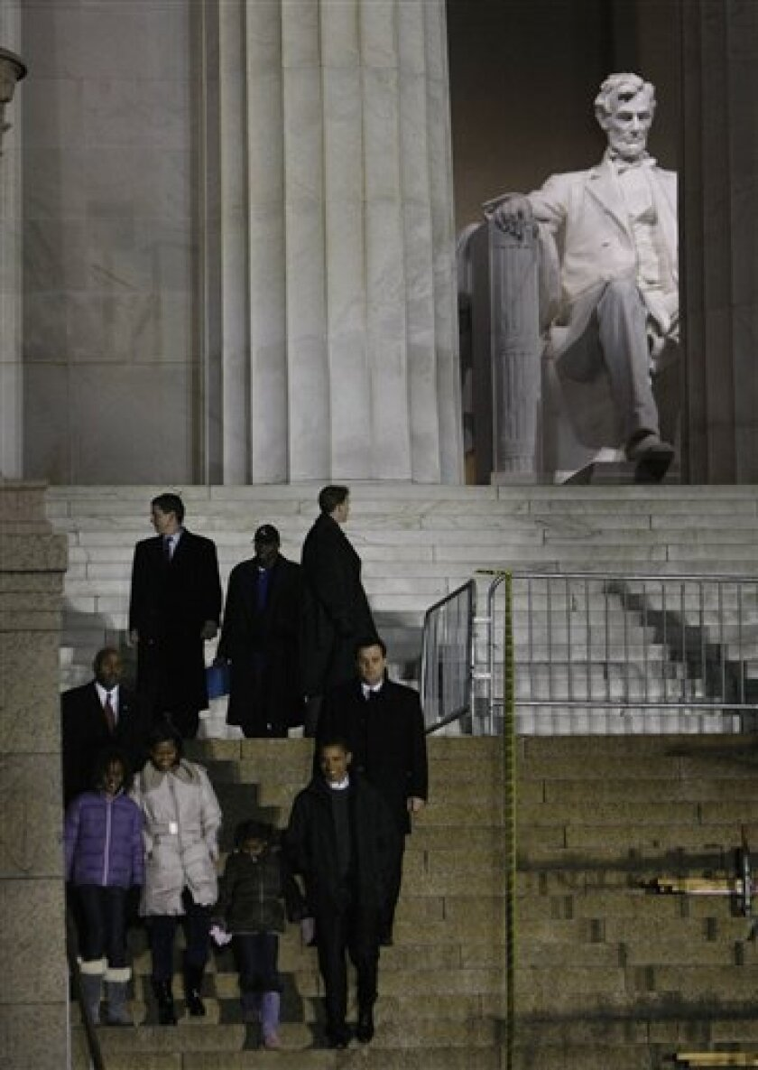 President-elect Barack Obama walks with his wife Michelle, and daughters Sasha and Malia, after touring the Lincoln Memorial in Washington, Saturday, Jan. 10, 2009. (AP Photo/Gerald Herbert)