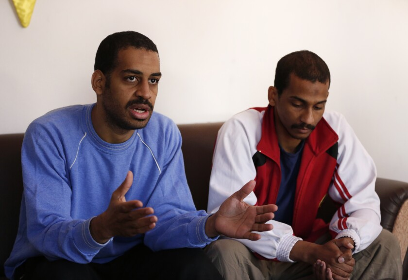 """FILE - In this March 30, 2019, file photo, Alexanda Amon Kotey, left, and El Shafee Elsheikh, who were allegedly among four British jihadis who made up a brutal Islamic State cell dubbed """"The Beatles,"""" speak during an interview with The Associated Press at a security center in Kobani, Syria. (AP Photo/Hussein Malla, File)"""