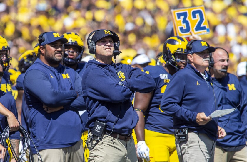 Michigan coach Jim Harbaugh, center, reacts looking up at the scoreboard in the second quarter against Army in Ann Arbor, Mich. on Saturday.
