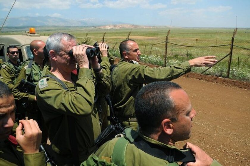 Israeli Military Chief of Staff Lt. Gen. Benny Gantz, with binoculars, and other officers observe Syria from the Golan Heights.