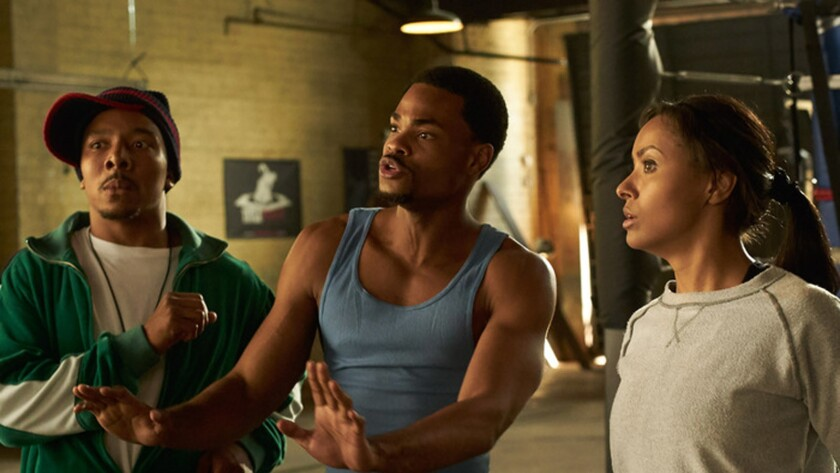 "Allen Maldonado, left, Andrew Bachelor and Kat Graham in the movie ""Where's the Money."""
