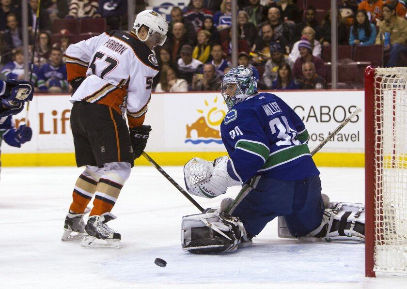 Anaheim Ducks' David Perron (57) is stopped by Vancouver Canucks goaltender Ryan Miller during the first period of an NHL hockey game Thursday, Feb. 18, 2016, in Vancouver, British Columbia. (Ben Nelms/The Canadian Press via AP)