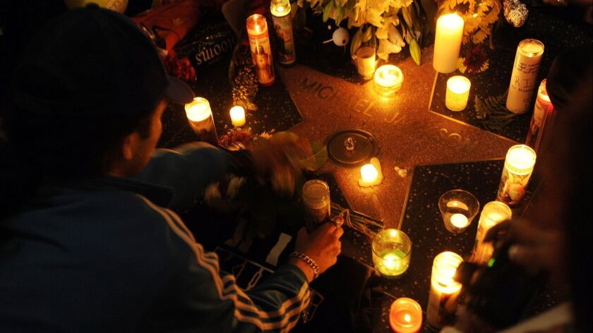 Michael Jackson fans gather around Jackson's star on the Hollywood Walk of Fame in Los Angeles, earl