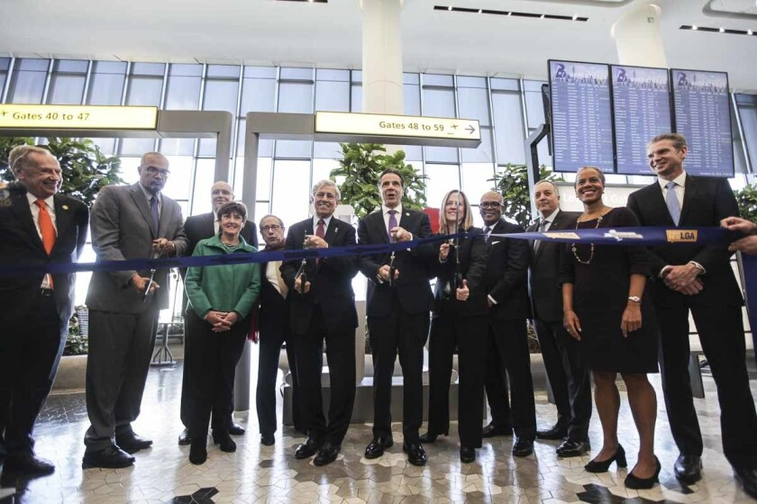 Gov. Andrew Cuomo, right center, cuts a ribbon with Richard Cotton, the Executive Director at Port A