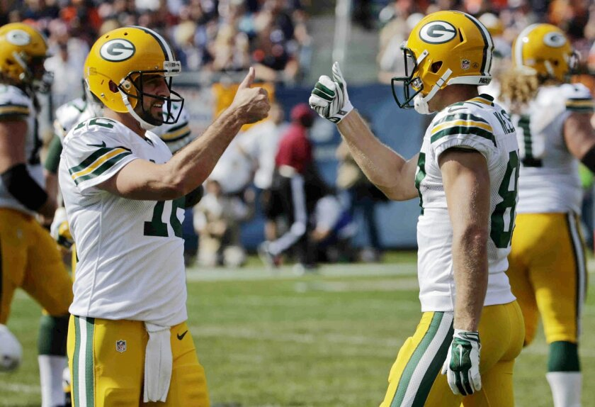 Green Bay Packers quarterback Aaron Rodgers (12) and wide receiver Jordy Nelson (87) celebrates a touchdown in the second half of an NFL football game against the Chicago Bears Sunday, Sept. 28, 2014, in Chicago. (AP Photo/Charles Rex Arbogast)