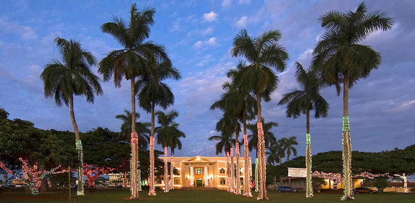 Tens of thousands of holiday lights glimmer on the grounds of the Historic County Building in Lihue on the island of Kauai. The Festival of Lights also focuses on folk art.