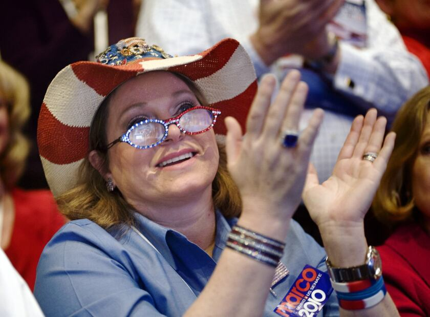 An attendee applauds a keynote speech at the 2010 Conservative Political Action Conference.