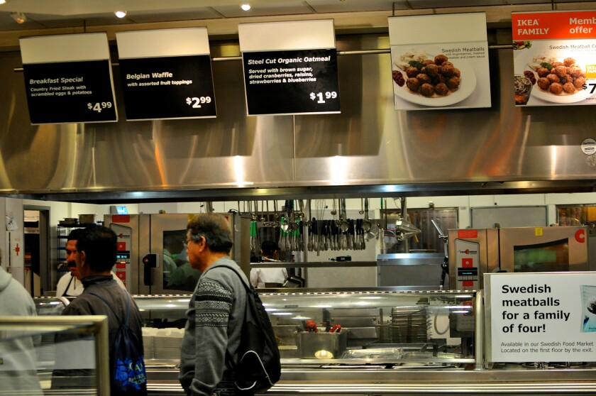 Diners wait in line at a restaurant inside an Ikea store.