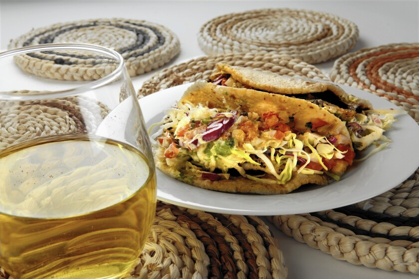 White wine is a refreshing accompaniment for summery fish tacos.