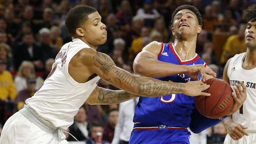 Arizona State guard Rob Edwards, left, knocks the ball away from Kansas guard Quentin Grimes during