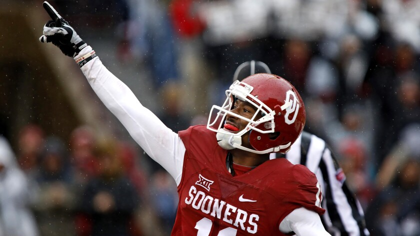 Oklahoma receiver Dede Westbrook celebrates a touchdown against Oklahoma State on Saturday.