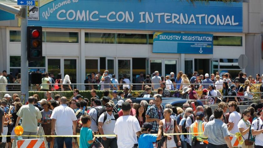 Large crowds of people head into the San Diego Convention Center for Comic-Con 2014 .