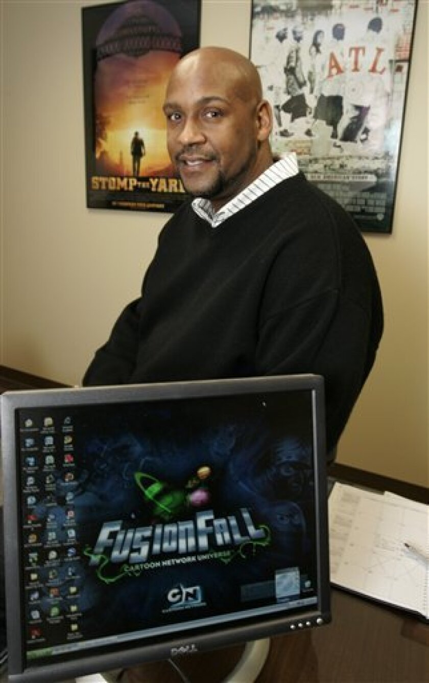 Asante Bradford, who is the digital entertainment liaison with Georgia's Department of Economic Development, poses in his Atlanta office Wednesday, Jan. 14. 2009, in Atlanta.  After Barack Obama's historic presidential win, Bradford gave his bosses nearly three month's notice that he would not be a