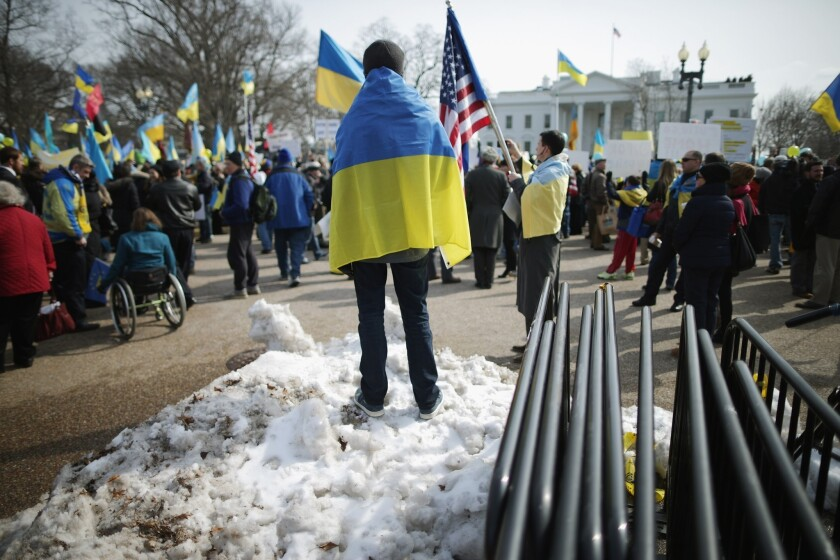 Demonstrators rally Thursday outside the White House in Washington to protest Russia's military incursion in Ukraine.