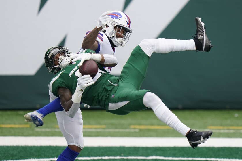 New York Jets' Blessuan Austin, bottom, breaks up a pass intended for Buffalo Bills' Gabriel Davis, top, during the first half of an NFL football game, Sunday, Oct. 25, 2020, in East Rutherford, N.J. (AP Photo/Frank Franklin II)