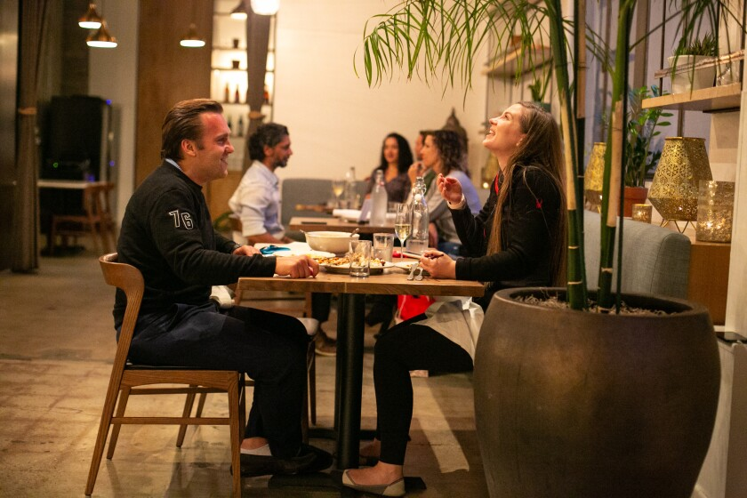 Patrons enjoy dinner at Cassia as the much loved restaurant reopens its indoor dining room.