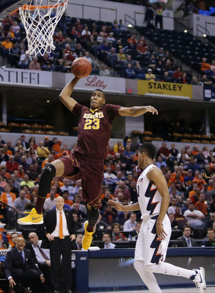 FILE - In this March 9, 2016, file photo, Minnesota's Charles Buggs (23) goes up for a dunk against Illinois' D.J. Williams (0) during the first half of an NCAA college basketball game at the Big Ten Conference tournament in Indianapolis. Buggs will leave the program to play elsewhere in his final year of eligibility, the Gophers announced Tuesday, May 31, 2016. Buggs received his undergraduate degree from the university earlier this month and will continue his career elsewhere while pursuing a graduate degree. (AP Photo/Kiichiro Sato, File)