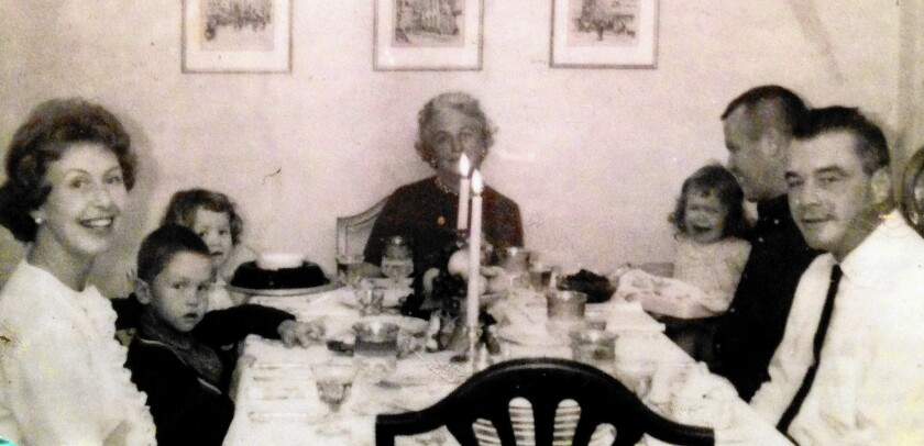 Columnist Chris Erskine's family gathered at the Thanksgiving table in the early 1960s. He's the boy on the left.