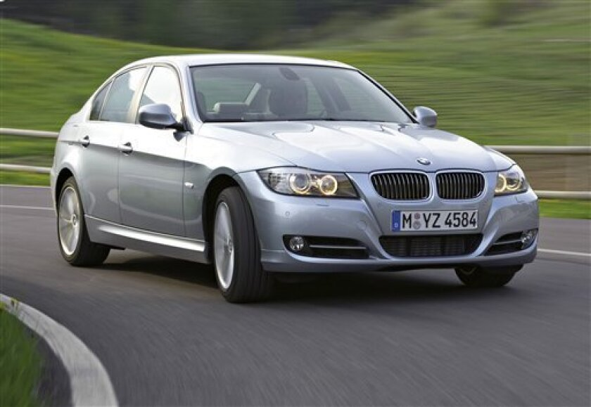FILE - This undated photo provided by BMW AG shows the 2009 BMW 3-Series sedan. BMW is recalling almost 570,000 cars in the U.S. and Canada because a battery cable connector can fail and cause the engines to stall. The recall affects popular 3-Series sedans, wagons, convertibles and coupes from the