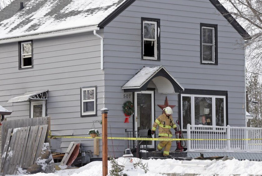 REMOVES REFERENCE TO NUMBER OF FATALITIES - Sheboygan Falls assistant fire chief Wade Ubbelohde leaves a home on the 500 block of Western Ave. in Sheboygan Falls, Wis., Wednesday, Jan. 27, 2016, the day after a fatal fire. (Mike De Sisti/Milwaukee Journal-Sentinel via AP) MANDATORY CREDIT