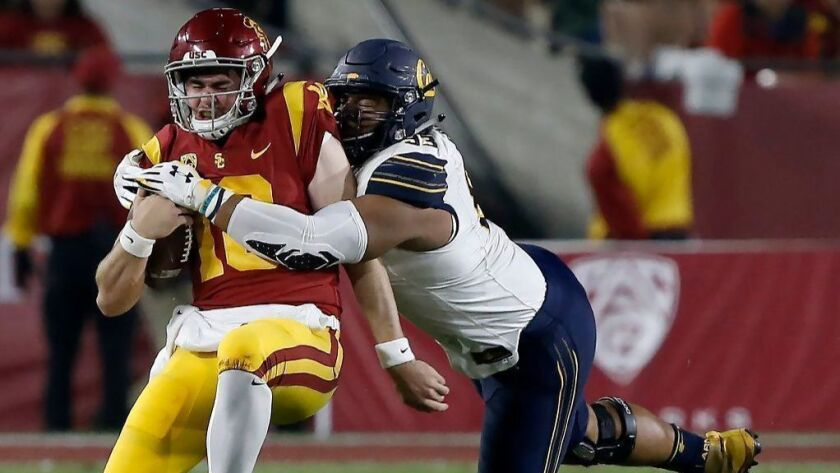 USC quarterback J.T. Daniels is sacked by California defensive end Luc Bequette during a game at the L.A. Memorial Coliseum on Nov. 10, 2018.