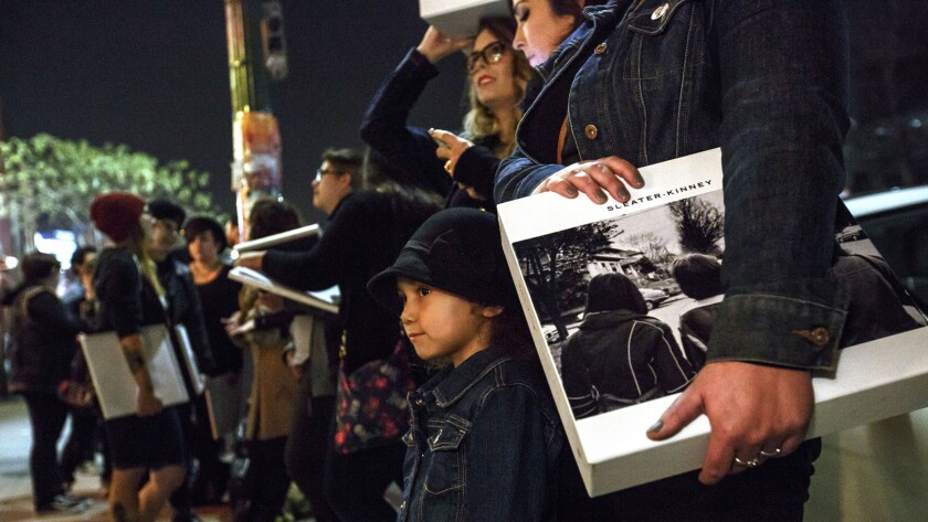 Charlotte Garcia of East Los Angeles waits in line at an in-store signing at Origami Vinyl record shop in Echo Park in January 2015.