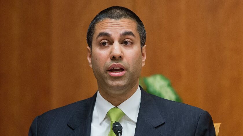 FILE - In this Feb. 26, 2015, file photo, Federal Communication Commission Commissioner Ajit Pai spe