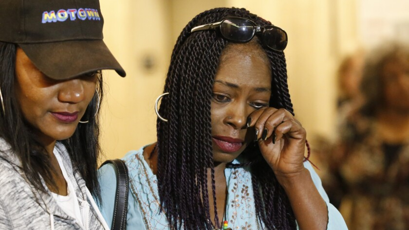 Kenneitha Lowe, right, sister of victim Mary Lowe, wipes a tear after a jury ruled for the death penalty.