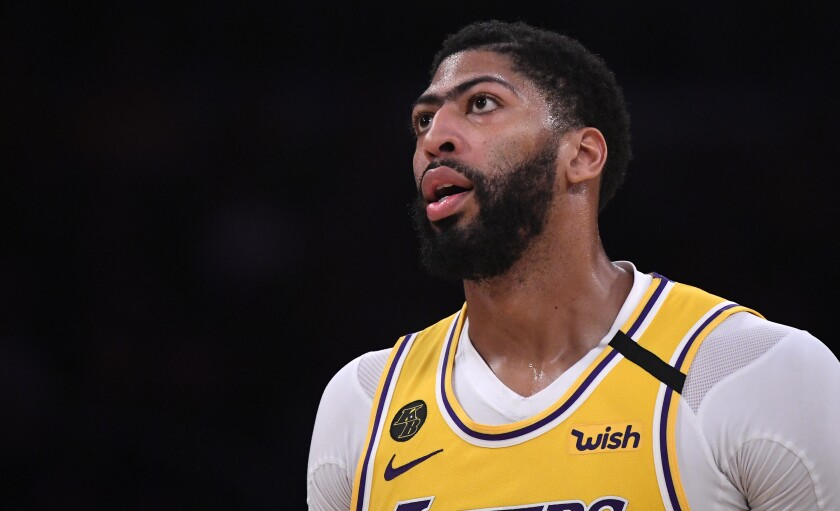 Lakers forward Anthony Davis was still experiencing discomfort Tuesday after being poked in the eye during a scrimmage.
