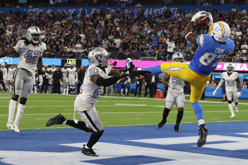Jared Cook of the Los Angeles Chargers scores a touchdown against the Las Vegas Raiders during the second quarter .