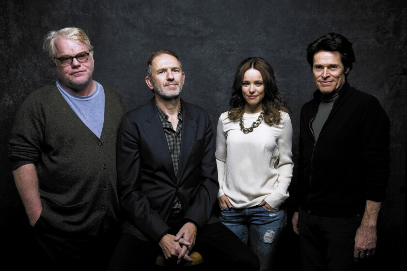 """The cast of """"A Most Wanted Man,"""" with Phillip Seymour Hoffman, left, director Anton Corbijn, Rachel McAdams and Willem DeFoe, in the L.A. Times photo & video studio at the 2014 Sundance Film Festival on Jan. 19, 2014."""