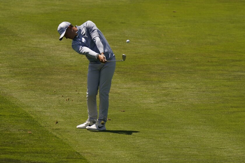 Cameron Champ hits from the fairway on the 18th hole during the second round of the PGA Championship golf tournament at TPC Harding Park Friday, Aug. 7, 2020, in San Francisco. (AP Photo/Jeff Chiu)