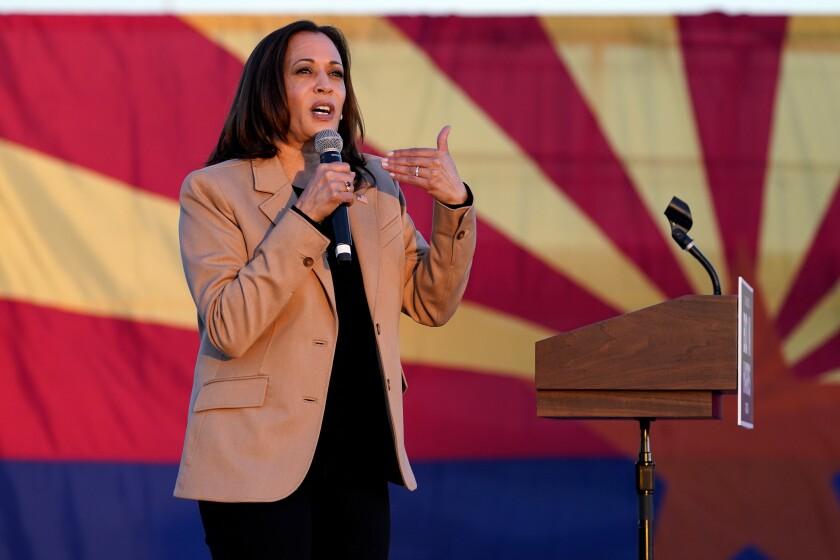 Democratic vice presidential candidate Sen. Kamala Harris, D-Calif., speaks at a mobile campaign event, Wednesday, Oct. 28, 2020, in Phoenix. (AP Photo/Matt York)