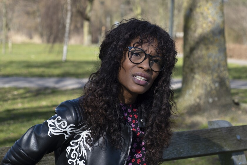 Sylvana Simons, who is campaigning for the Dutch general election on a platform of what she calls radical equality, poses for a portrait in Amsterdam, Netherlands, Friday, March 5, 2021. Sylvana Simons, a former television presenter who is arguably the best-known Black Dutch woman is leading a small party that wants to put ending racial inequality front and center on the political stage before and after the Netherlands' general election. Voting for the the lower house of parliament's 150 seats begins Monday March 15 and ends Wednesday March 17. (AP Photo/Mike Corder)