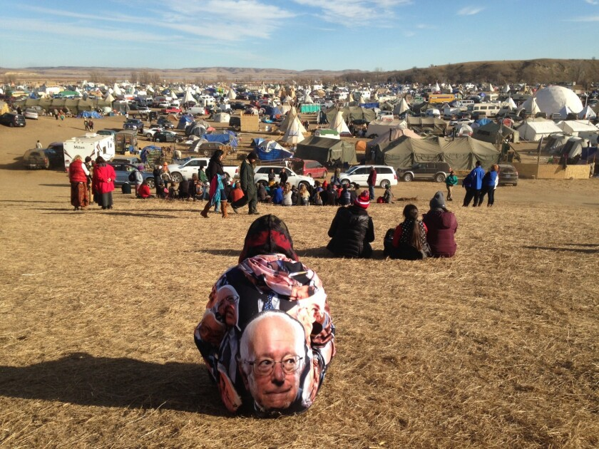 Protesters gather at an encampment near Cannon Ball, N.D., on Saturday, a day after tribal leaders received a letter from the U.S. Army Corps of Engineers saying the federal land would be closed to the public Dec. 5.